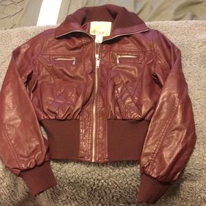 A burgundy faux leather bomber jacket
